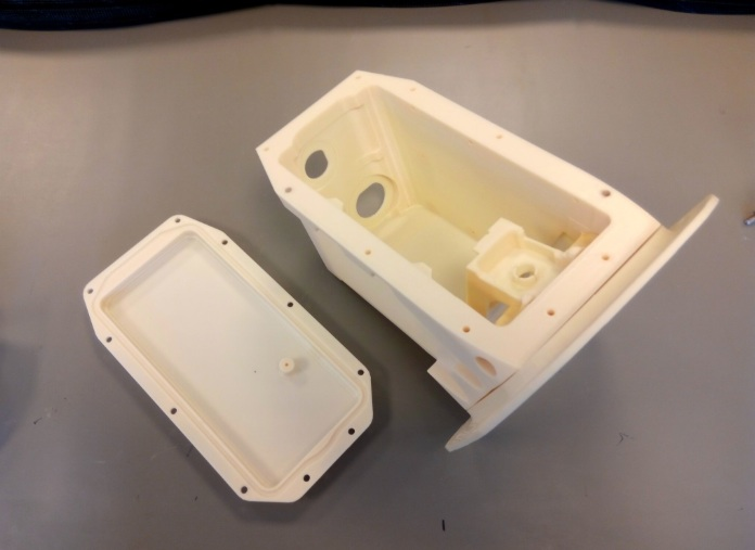 Prototype de boîtier d'appareil-photo imprimé en 3D pour l'Airbus A380, produit sur l'imprimante 3D Fortus 450mc Production de Stratasys avec le matériau ULTEM 9085